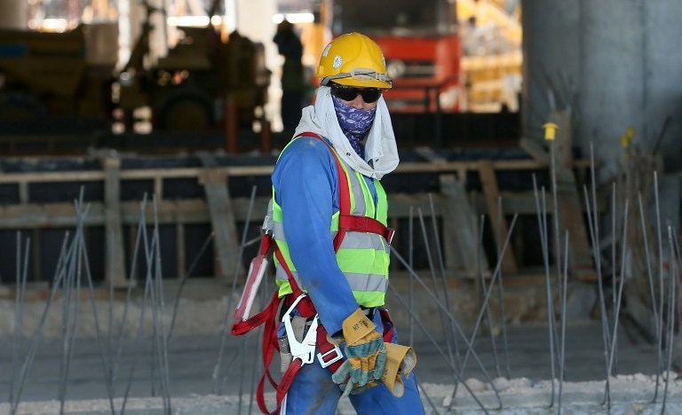 A migrant labourer in Doha in October 2013
