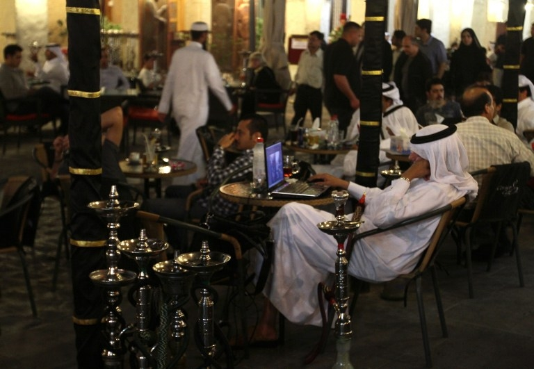 A Qatari man works on his laptop at the Souq Waqif market in the old city of Doha in March 2010