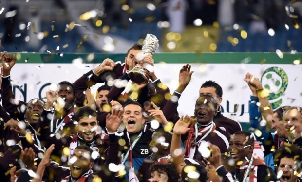 Qatar players celebrate after defeating Saudi Arabia 2-1 in the final of the Gulf Cup