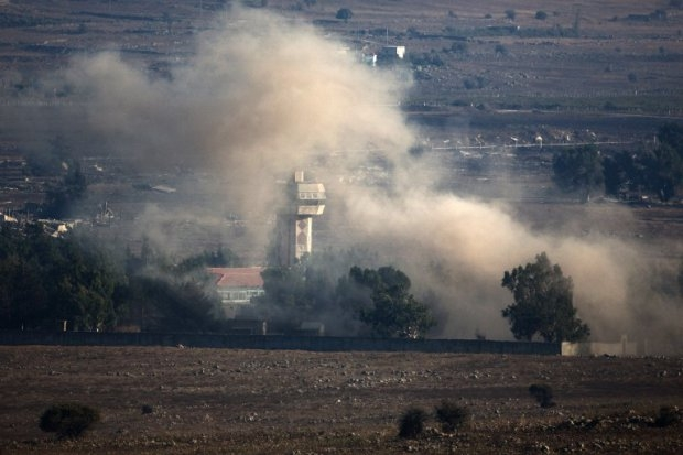 In a picture taken from the Israeli-annexed Golan Heights, smoke billows from the Syrian village of Quneitra following an explosion during fighting on August 31, 2014