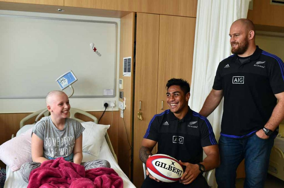 All Blacks players visit a children's cancer unit at a Cardiff hospital.