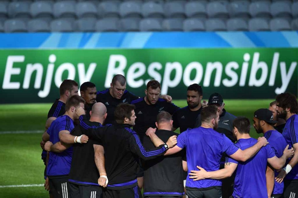 All Blacks huddle at the end of a training session.