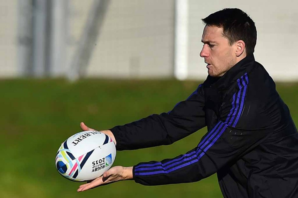 All Blacks fullback Ben Smith passes a ball during training.