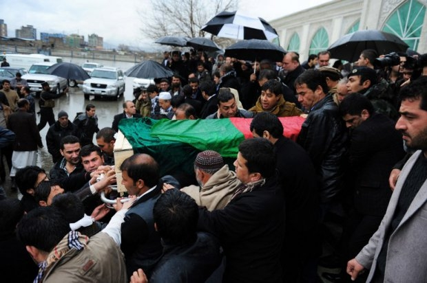 Friends and family of Afghan AFP reporter Sardar Ahmad carry his casket as they leave a mosque and head to the cemetery during his funeral in Kabul on March 23, 2014