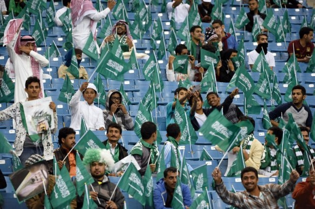 Fans of the Saudi national team cheer before the final of the Gulf Cup of Nations