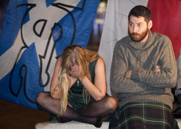 Pro-Independence supporters in Edinburgh show sadness as referendum results are announced