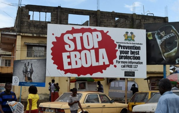 A billboard with a message about Ebola in Freetown, on November 7, 2014. (AFP PHOTO/ FRANCISCO LEONG)