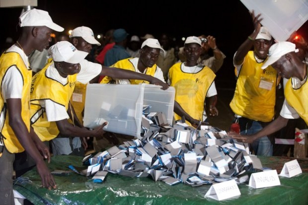 Polling officials empty ballot boxes in Juba on January 15, 2011, after South Sudan's independence vote