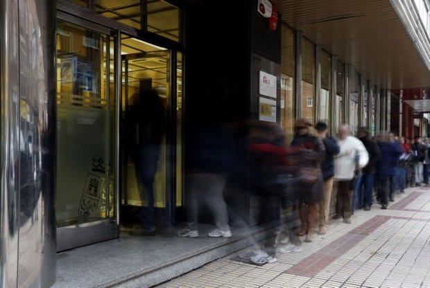People queuing outside a job centre in Burgos, Spain, February 2013