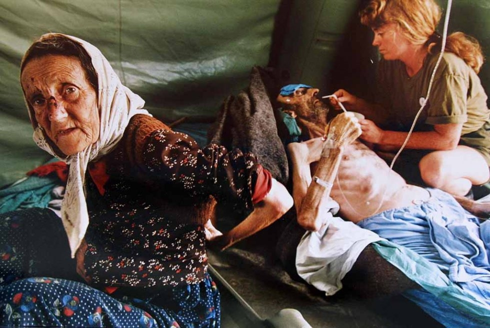 An elderly Muslim couple are treated for injuries inflicted by Serb forces as they fled Srebrenica. The man on the right died shortly afterwards.
