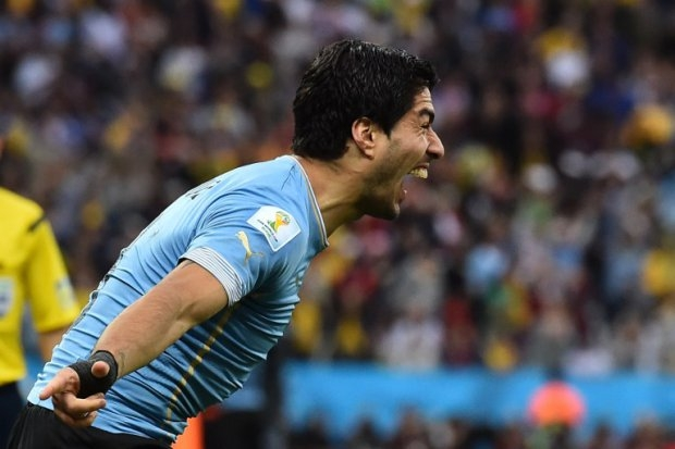 Luis Suarez celebrates one of his two goals against England in à São Paulo, June 19, 2014