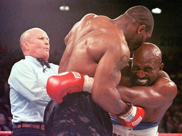 Another infamous bite: Mike Tyson chews off part of Evander Holyfield's ear during a heavyweight championship fightin Las Vegas, June 26, 1997.