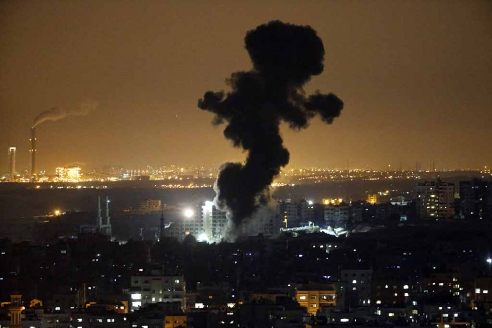 Smoke rises over Gaza after an Israeli strike. July, 2014.