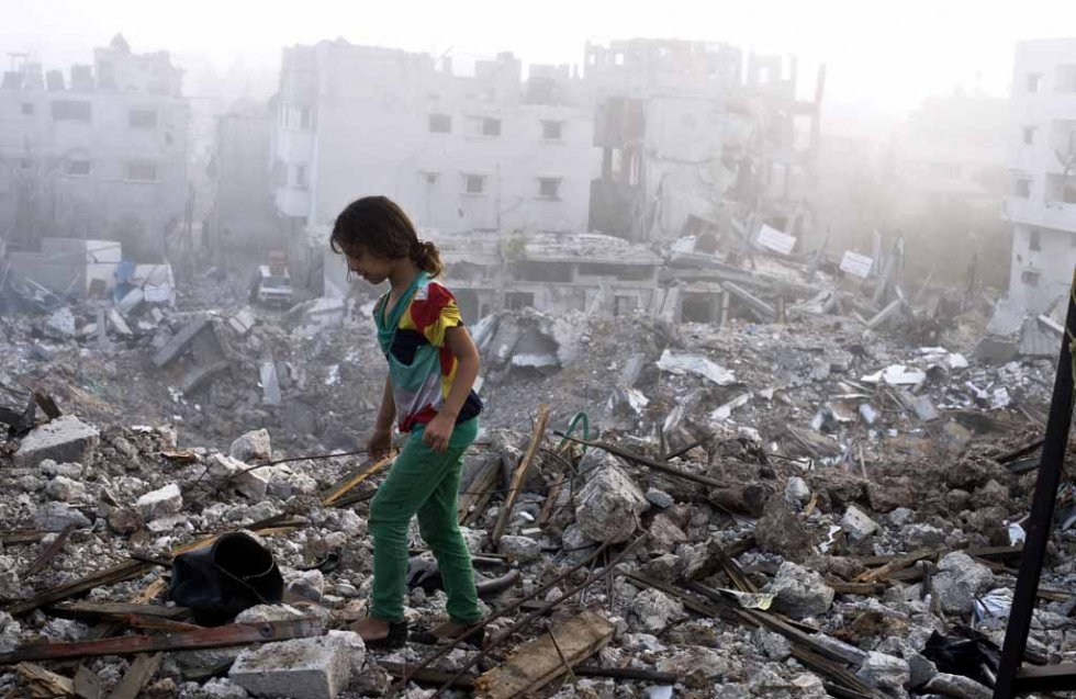 A child walks through the rubble her home in Gaza. August, 2014.