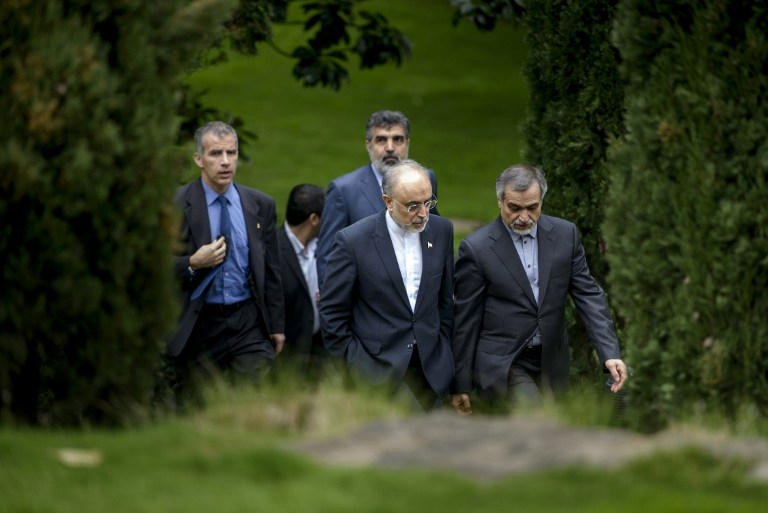 Iranian Atomic Energy Organization head Ali Akbar Salehi and Hossein Fereydoon, special assistant to the Iranian president, in a garden at the Beau Rivage in Lausanne on April 2, 2015