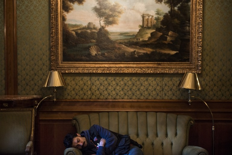 A journalist naps after Iran nuclear program talks extend into the early morning at the Beau Rivage Palace Hotel in Lausanne, Switzerland, on April 1, 2015