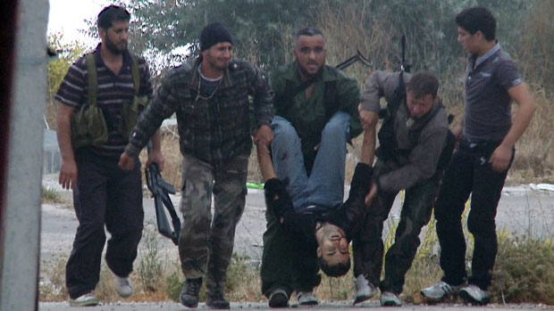 Syrian rebels carry the body of their slain comrade at Krak des Chevaliers in June 2012