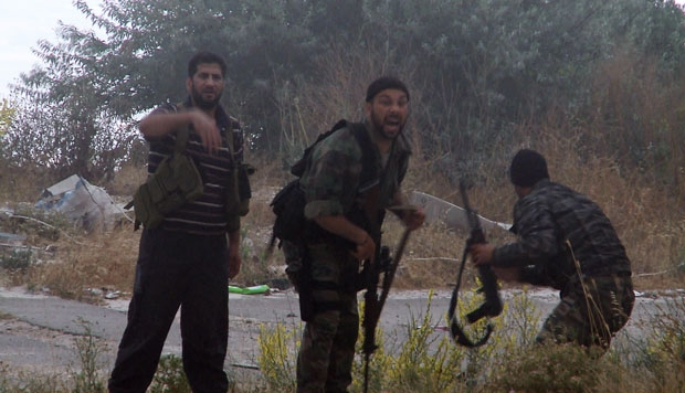 Syrian rebels call for help after their comrade is shot at the Krak des Chevaliers in June 2012