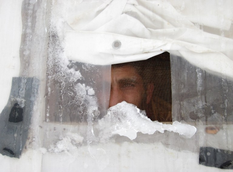 A Syrian refugee looks out of his tent in Lebanon's Bekaa valley, on January 7, 2015