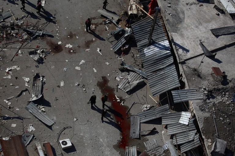 Blood and debris following air strikes by government forces in Douma, Syria on February 5, 2015