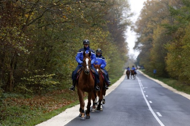 French mounted gendarmes search for the 'tiger' in the woods of Ferrieres-en-Brie
