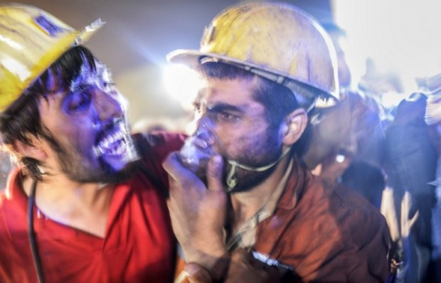 A miner celebrates seeing his friend emerge alive after the Soma mine blast on May 13, 2014