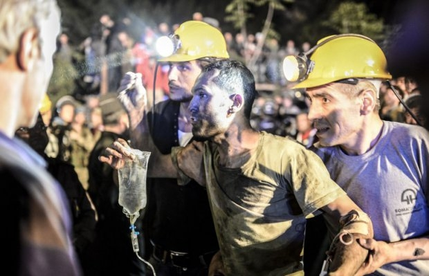 A miner is helped by his friends in Soma on May 13, 2014