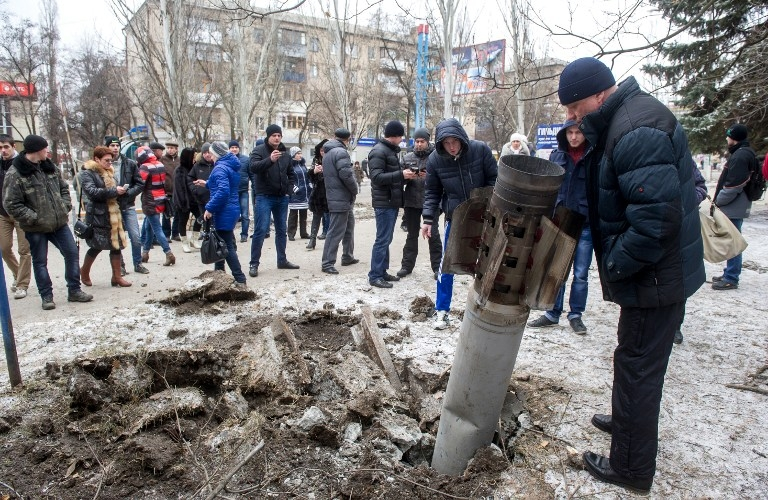 An unexploded missile is embedded in a street of Kramotorsk on February 10, 2015