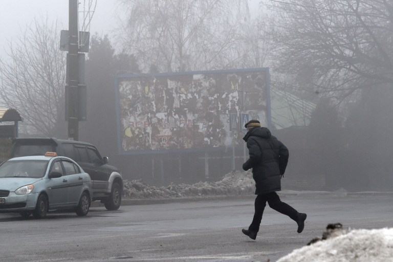 A man runs for cover in Donetsk's Kyibishevsky district, on January 30, 2015