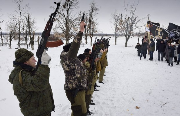 Donetsk People's Republic fighters fire in the air at the Savur-Mogyla memorial in eastern Ukraine