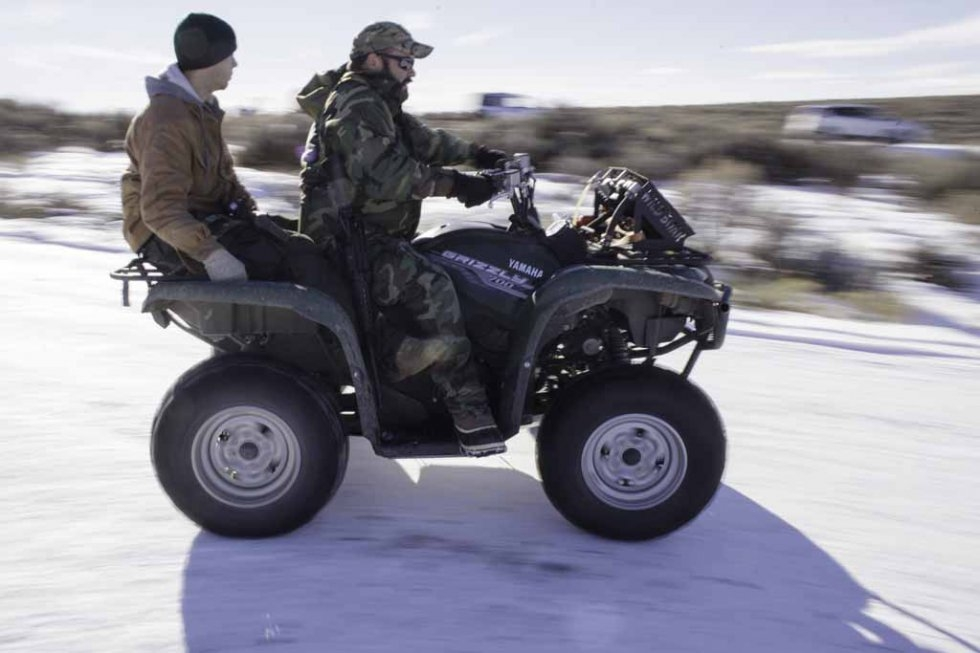 Two of the occupiers, armed with rifles, ride a four-wheeler. January 15, 2016.