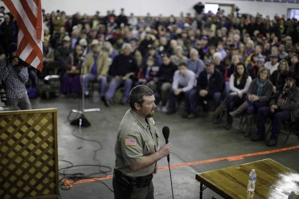 Harney County Sheriff David Ward addresses the community meeting at the fairgrounds on January 6, 2016.