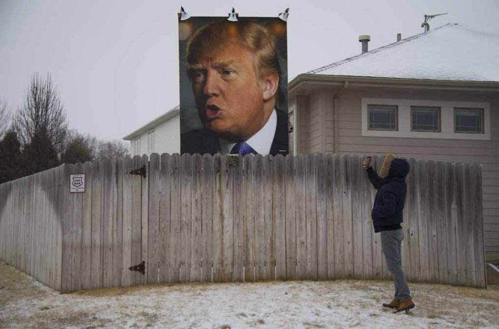 A poster of Donald Trump in an Iowa backyard.