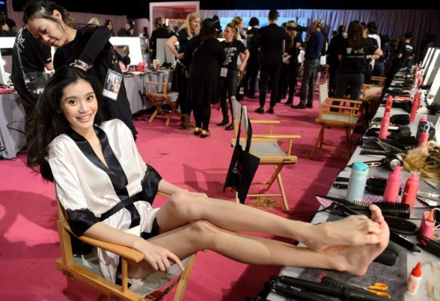 Chinese model Ming Xi backstage at the 2014 Victoria's Secret Fashion Show in London