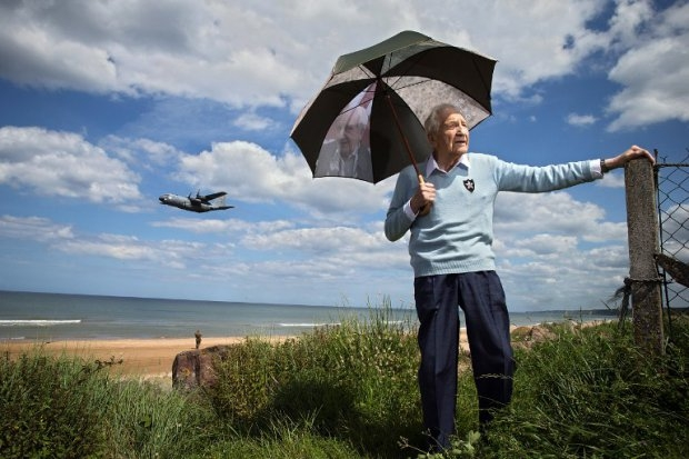 Bernard Dargols on Omaha Beach, June 5, 2014, as a Hercules plane flies by.