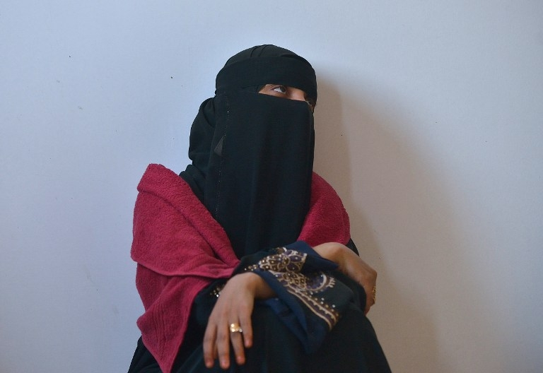 A Yemeni woman sits in her quarters at a UNHCR facility at Obock in Djibouti on April 13, 2015