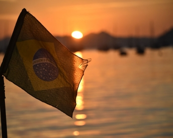 The Brazilian flag flys at sunrise on the  Botafojo beach in Rio de Janeiro during the 2014 FIFA World Cup football tournament on June 25, 2014