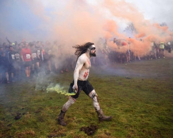 Competitors prepare to start the 'Tough Guy' adventure race near Wolverhampton, central England, on January 29, 2017.  The Tough Guy event, which is being held for the final time in its 30th year, challenges thousands of competitors to run a gruelling cou