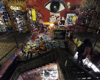 A person walks down the stairs in one of Berlin's most famous artist colonies, the Kunsthaus Tacheles, taken on January 29, 2010. The  building known as the Tacheles (Yiddish word for plain, honest, straightforward talk) was erected in the 20th century