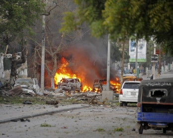 This picture taken on June 1, 2016, shows a car bruning after a terror attack at the Ambassador Hotel, after Somalia's Al-Qaeda-linked Shabaab, launched a deadly attack on a top Mogadishu hotel popular with MPs, setting off a car bomb and fighting securit