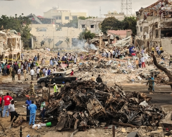 / A picture taken on October 15, 2017 shows a general view of the scene of the explosion of a truck bomb in the centre of Mogadishu.
