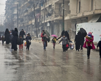 Syrians leave a rebel-held area of Aleppo towards the government-held side on December 13, 2016 during an operation by Syrian government forces to retake the embattled city.