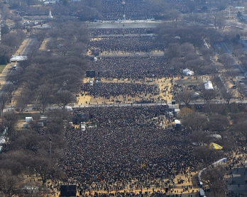 People gather on the National Mall in Washington, DC, to watch the inauguration of US President-elect Barack Obama as 44th US president January 20, 2009.