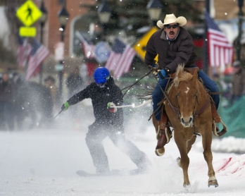 Rider Jorge Calzadillas races down Harrison Avenue while towing a skier during the 68th annual Leadville Ski Joring weekend competition on March 5, 2017 in Leadville, Colorado.