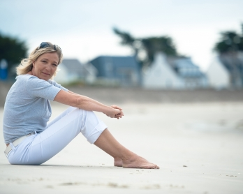 This file photo taken on July 28, 2010 shows French far right party, the National Front's (FN) vice-president Marine Le Pen posing on the beach in La Trinite-sur-Mer, northern France.