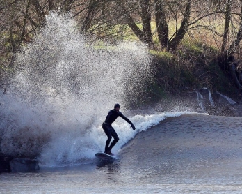 Riding the tidal bore on the River Severn at Minsterworth, southwest England on March 21, 2015