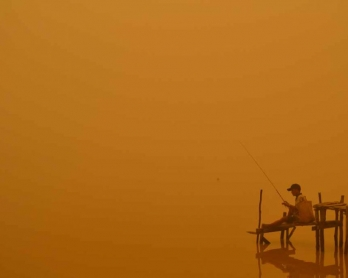 A fisherman by the river in Palangkaraya in October. (AFP/Haris Sadikin)