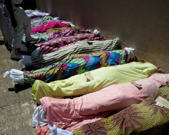 Bodies of victims from twin bomb blasts in the central city of Jos, which killed 44 people, are prepared for burial, July, 2015.