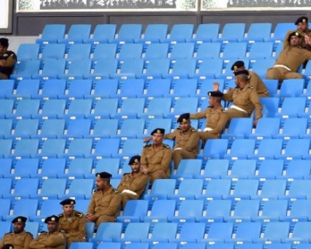 Saudi police sit in the stands during the 22nd Gulf Cup football tournament at the Prince Faisal bin Fahd Stadium in Riyadh on November 25, 2014 (AFP PHOTO/ FAYEZ NURELDINE)