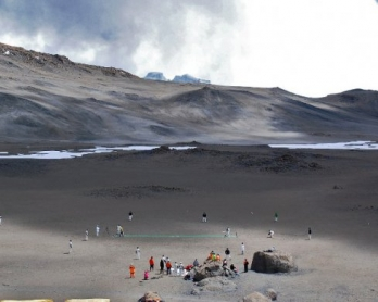 Cricketers play on September 26, 2014 on the ice-covered crater of the Kilimanjaro mountain, Tanzania